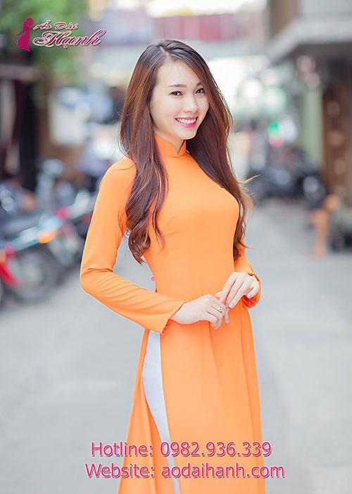 Áo dài màu cam tay dài