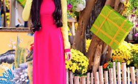 Áo dài hồng sen lụa tay vàng cho ngày xuân