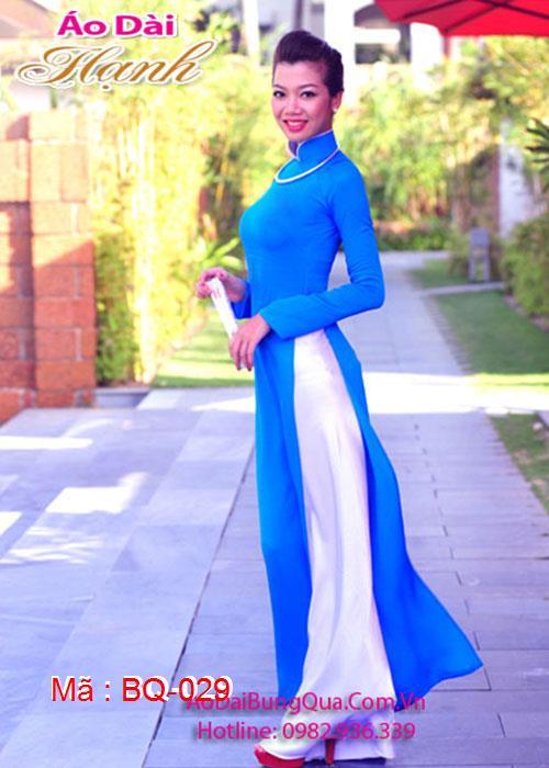 Áo dài xanh dương lụa trơn cổ truyền thống viền trắng tay dài