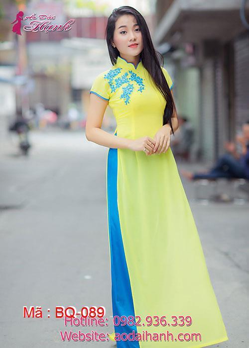Áo dài vàng tươi chiffon đắp bông xanh cổ hoa tay ngắn
