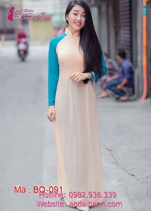 Áo dài cam sữa chiffon tay xanh lý cổ truyền thống