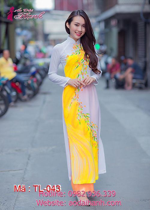 Áo dài trắng voan in hoa vàng cổ truyền thống tay dài