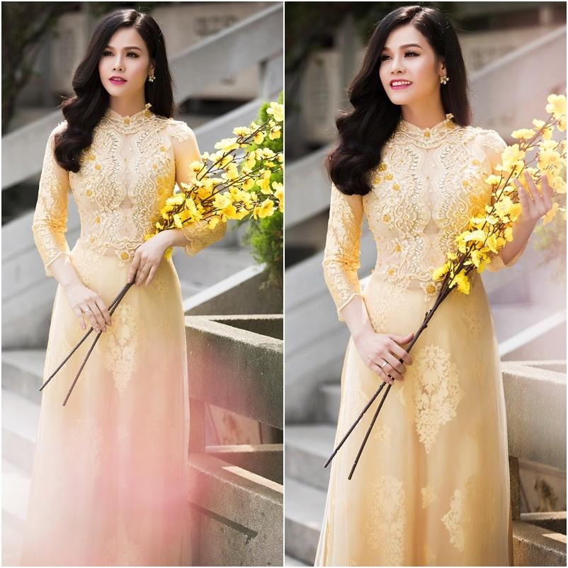 may áo dài cô dâu đám cưới màu vàng kim đính cườm